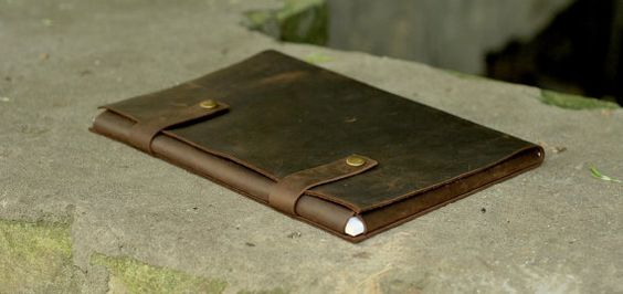 Handmade genuine leather folder for papers and documents. Folder closes with two steel buttons on straps. This leather case will keep your documents