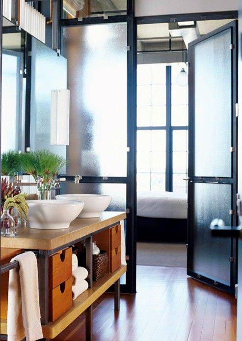 Close off shower/toilet area from sink. Use frosted glass walls/doors between the two areas.