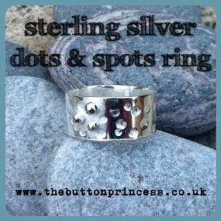A new addition to my ring collection...   The Button's Dots 'n Spots ring.   Similar to Dottie but with the addition of three lil' silver pearl spots.   The ring is made using 925 silver and is 8mm wide and a size L½, but can be made to size.   £25 plus p&p   If you are interested in commissioning a piece of Button Princess Silver please drop me a line at info@thebuttonprincess.co.uk to discuss.   #silver #jewellery #jewelry #handmade #ring