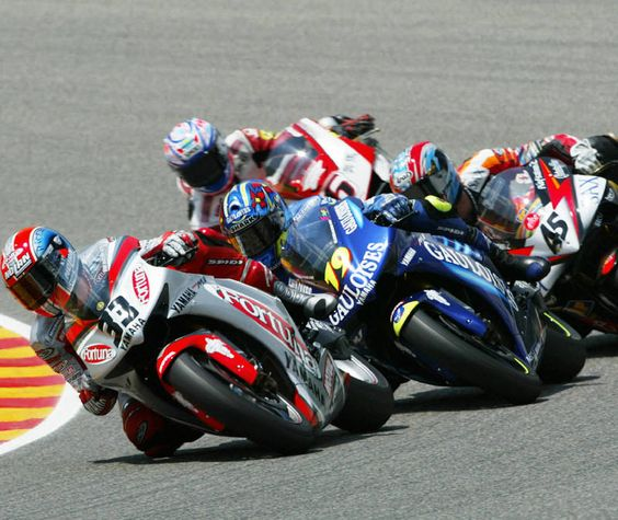 Melandri leads Jacque, Edwards and Tamada in close formation.
