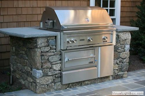 Outdoor grill station close to the wall of the house for Outdoor grill cabinet design