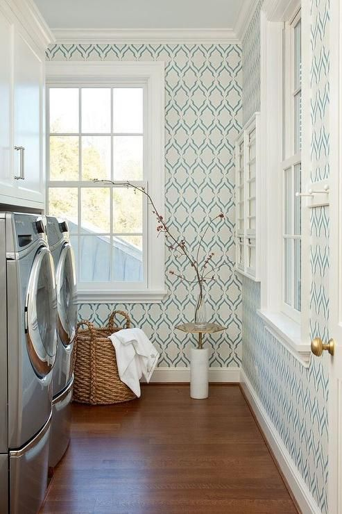 White And Blue Laundry Room Features Walls Clad In Christopher