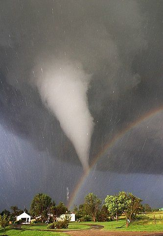 Oklahoma - where the wind comes sweeping down the plain.....where rainbows and tornadoes  can be captured in the same photograph! ; )