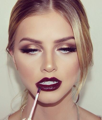Bronze smokey eyes paired with a bold wine lip.: