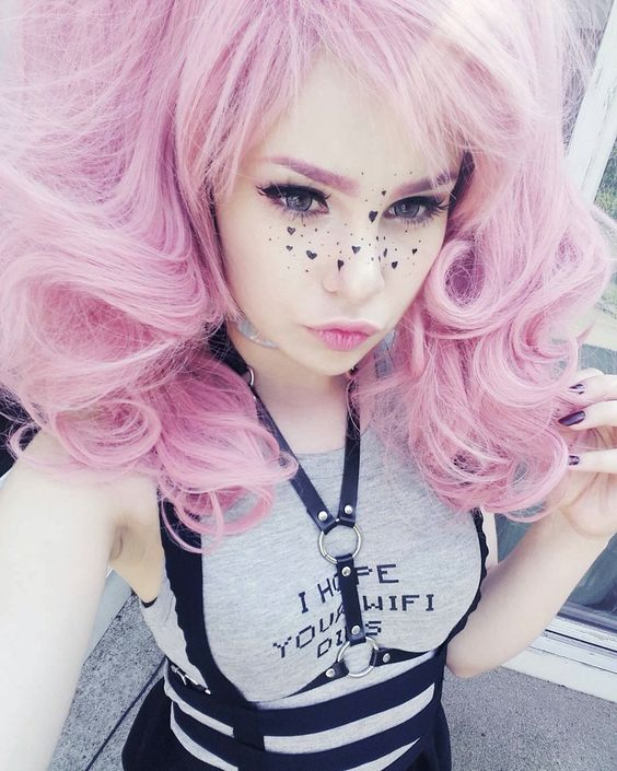 Pink hair and heart freckles. A nice idea for a photo!