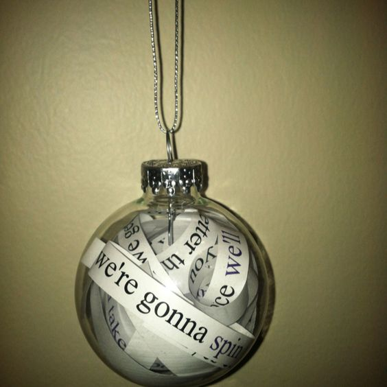 Thinking of doing Christmas ornaments as our favors- since we both LOVE Christmas! Lyrics to our 1st dance, or a Bible verse?