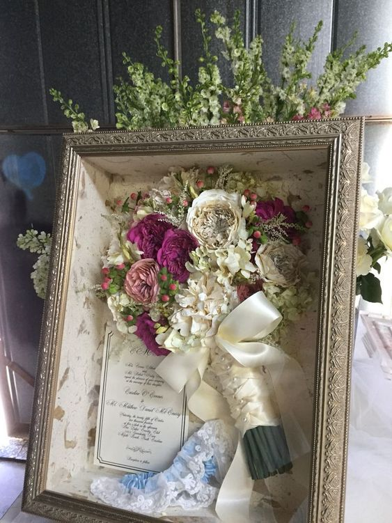 Love that the garter is included in this preserved bouquet shadowbox! #weddingga... #bouquet #garter #included #preserved #shadowbox #weddingga #weddingmementos