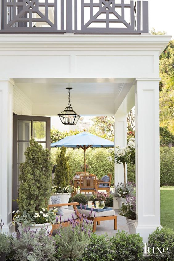 Love this traditional overhang with mouldings and square pillars/perfect for addition off family room with deck off master