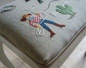 Sally Nencini's etsy shop http://www.etsy.com/listing/50129312/hand-embroidered-cowboy-stool