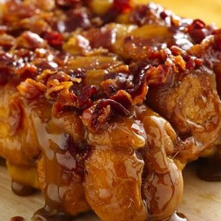 "Bacon Monkey Bread! - Mix together Maple Syrup, Melted Butter, Brown Sugar, and Crumbled Bacon.  Pour in a pan, cover with uncooked ""Biscuit Balls"", Bake, then Flip!  Enjoy!"