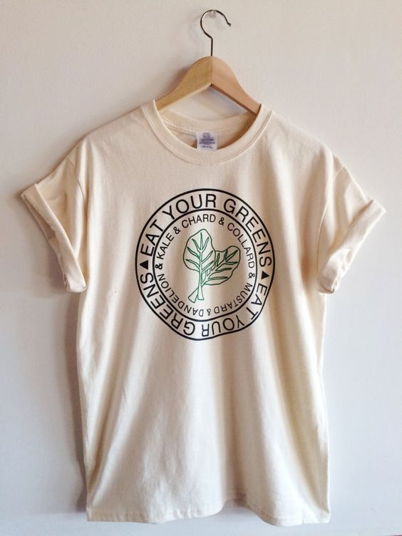 Hand Printed and Hand Drawn! Show your love of greens with this 100% cotton screen printed t shirt. It features hand drawn collard green leaves and
