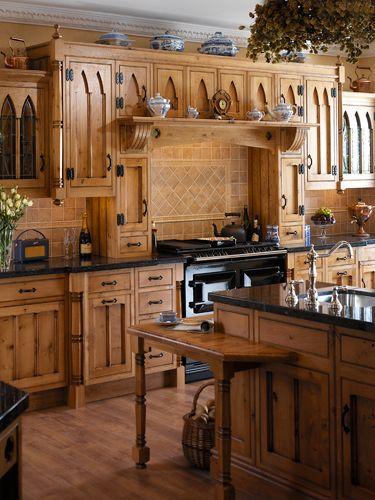 Black granite black countertops and black granite for Black country kitchen cabinets