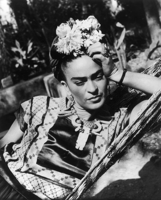 Artist Frida Kahlo expressed her love for the natural world, incorporating flowers from her garden into her art and personal style. (Photo: Getty Images)