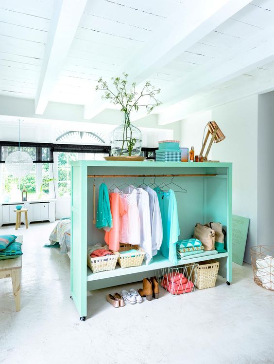 """Room Division in a studio doubles as an open closet. Love it! Home """"Alone"""": Small Space Hacks for Creating Privacy At Home"""
