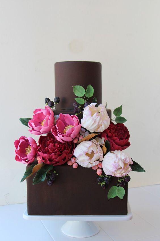 Square and round chocolate wedding cake
