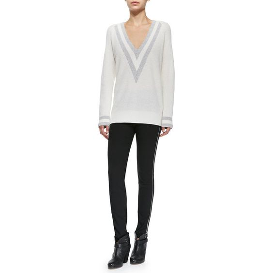 "Rag & Bone ribbed cashmere ""Talia"" sweater with colorblocking at neckline and cuffs. Deep V neckline. Long sleeves. Relaxed fit. Pullover style. Imported."