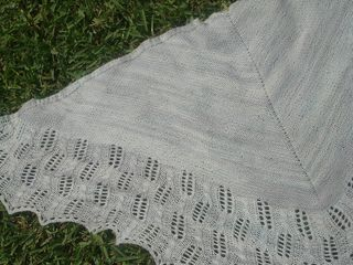 This a bottom-up triangular shawl, worked in two sections. It has a lace section and a reverse stockinette section.