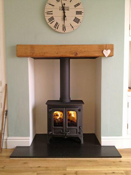 Charnwood Island 1 on honed granite hearth with oak fireplace beam.