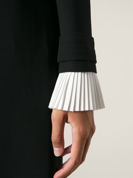 Visit our blog for more inspiration! pleats, pleated wrist cuffs, designer wrist cuffs, designer clothing, fall fashion, fashion trends, party wear, women's fashion, day wear, luxury clothing, fashion photoshoot, elegant look, evening wear, minimalist fashion, designer blouse, pleated blouse