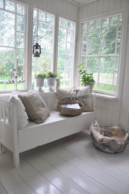 White cottage sunroom. I love the windows.: