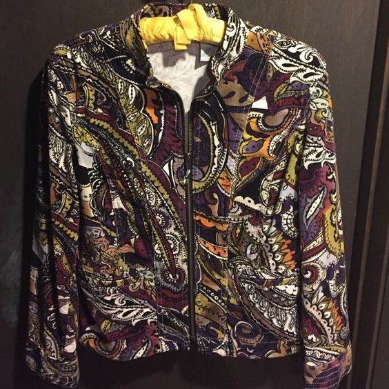 Chico's paisley jacket Beautiful Paisley Chicos jacket. Zips in the front. Two pockets in the front. Nice lines in front and back. It is 98% cotton and 2% spandex. It has the feeling of a light corduroy fabric. Chico's Jackets & Coats