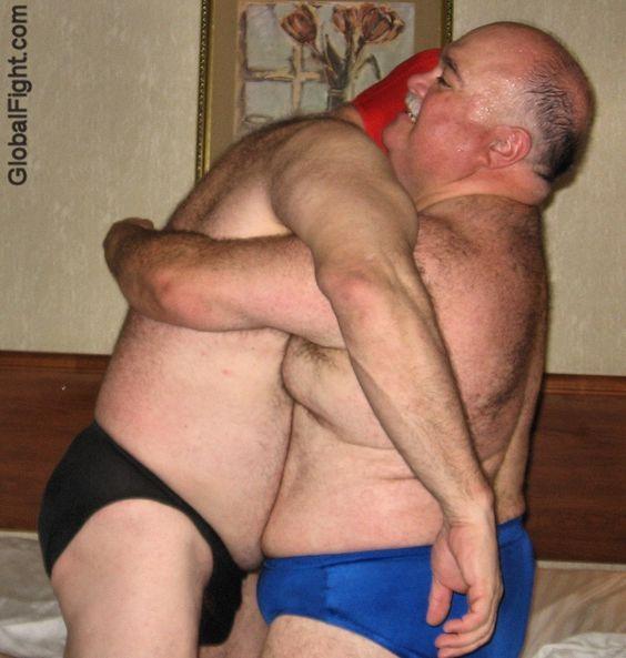 big bears hugging fighting hotel bedroom matches