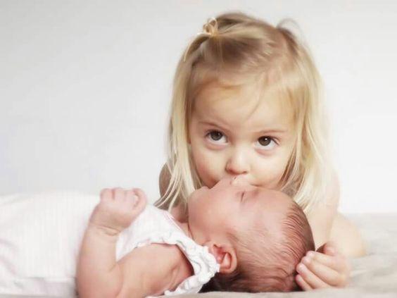 Sibling love. Beautiful photo of sisters. Newborn photography