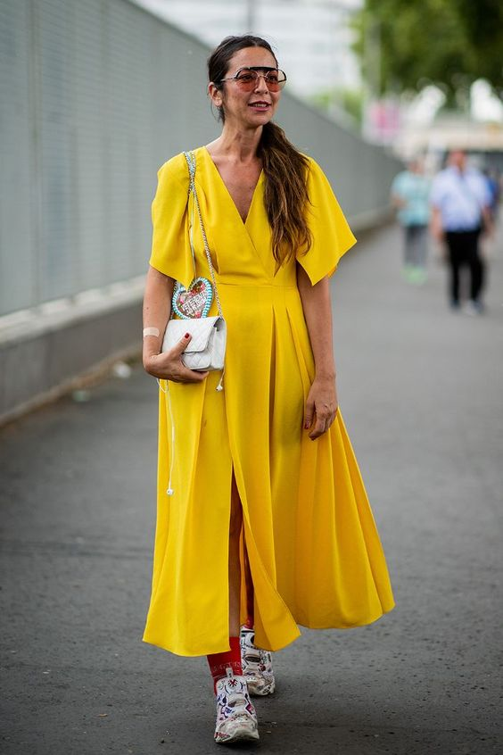 Haute Couture Fashion Week street style July 2018: showgoer wears yellow dress and trainers