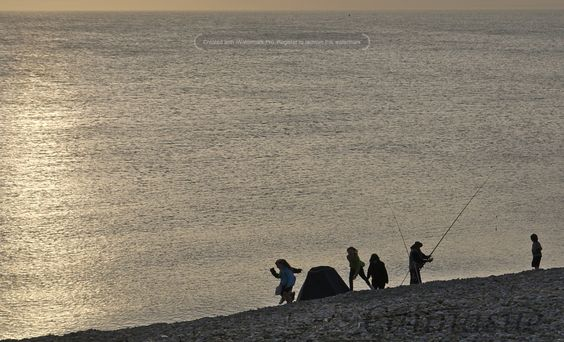 Fishing and families Chesil beach Portland.