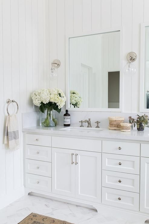 Transitional White Themed Bathroom With Dual Shaker Cabinet Washstand Topped With A Silver Wh Traditional Bathroom Designs Traditional Bathroom Marble Bathroom