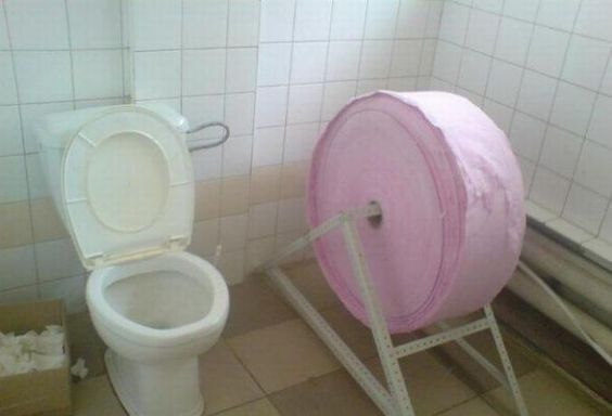 Taco Bell Post Mortem A toilet next to a gigantic roll of toilet paper