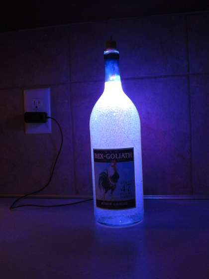Recycle an old cell phone charger and wine bottle into a gel filled LED lamp. Parts needed: - empty wine bottle and cork (I used a 1.5L bottle) - wire - blue and red LEDs - 220 Ohm and 100 Ohm resistors - small toggle switch - gel candle wax