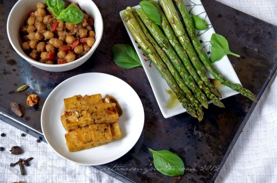 Roasted asparagus with pumpkin seed oil vinaigrette. Served with spicy chickpeas and cumin lime tofu.