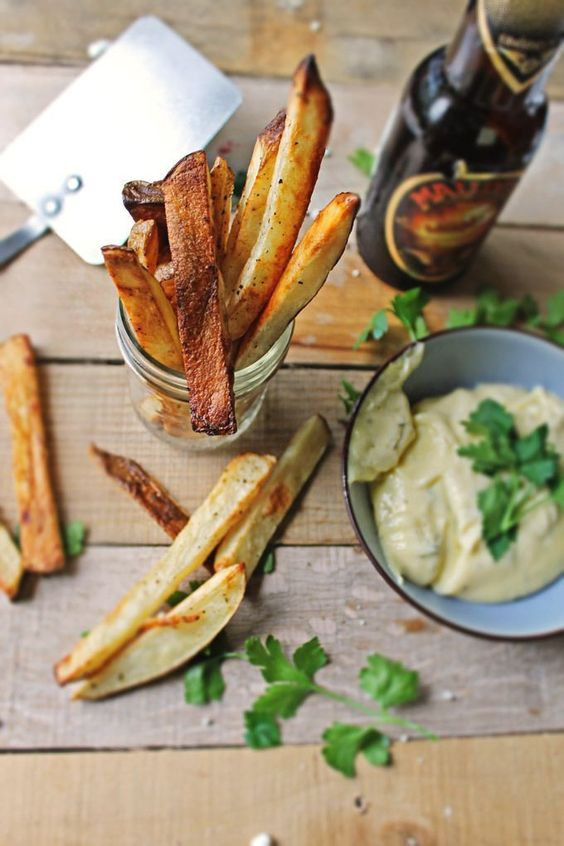 Beer marinated fries with thyme mayonnaise! Thick cut russet potatoes marinated in Belgian beer, baked to a golden crisp, and served with a homemade thyme mayonnaise. A Belgian favorite!