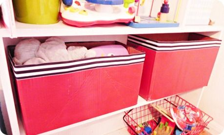 Spray-paint diaper boxes and glue ribbon around top for some new toy storage. GENIUS.