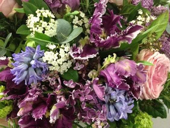 Nothing beats lilac, especially with virburnums tinus and opulus, roses,parrot tulips and hyacinths. The scent from this design is heavenly.