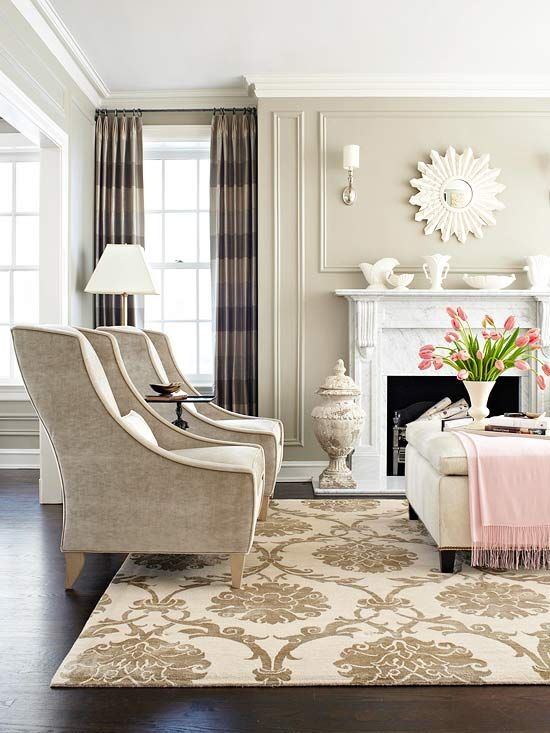 So many things to love in this living room- the rug, those chairs, a sunburst mirror, and a pretty pink throw for a just right pop of color.  And the pattern on that rug...stunning!: Decorating Idea, Wall Color, Livingroom, Living Room, Family Room, Pink Accent