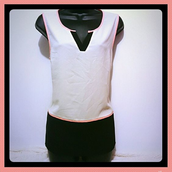 Black and white tank The white part is more of an off white. Black waist that is a little skirted. Peach orange lining around sleeves waist and back side of collar. 41 Hawthorn Tops Tank Tops