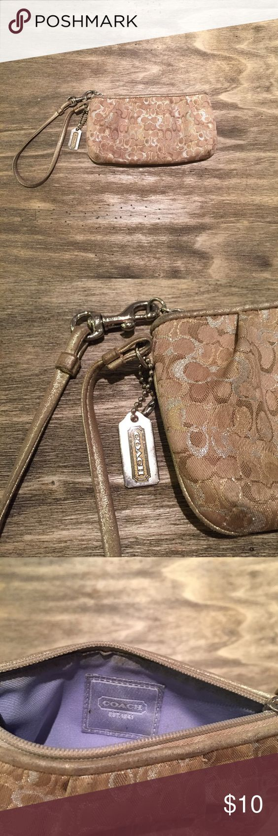 Gold Coach Wrislet Gold color wristlet with the Coach print. Inside is lavender with a little makeup marks. Coach Bags Clutches & Wristlets