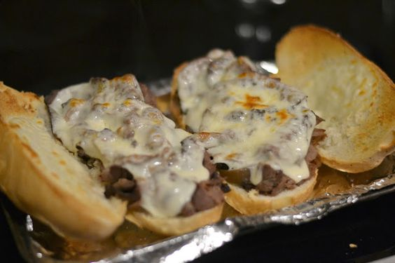 Really Easy French Dip Sandwiches - Deli roast beef, sliced thinly (1/2 pound to make two sandwiches) Provolone cheese Chicago rolls or hoagie rolls 1 can French onion soup 1 can beef consomme