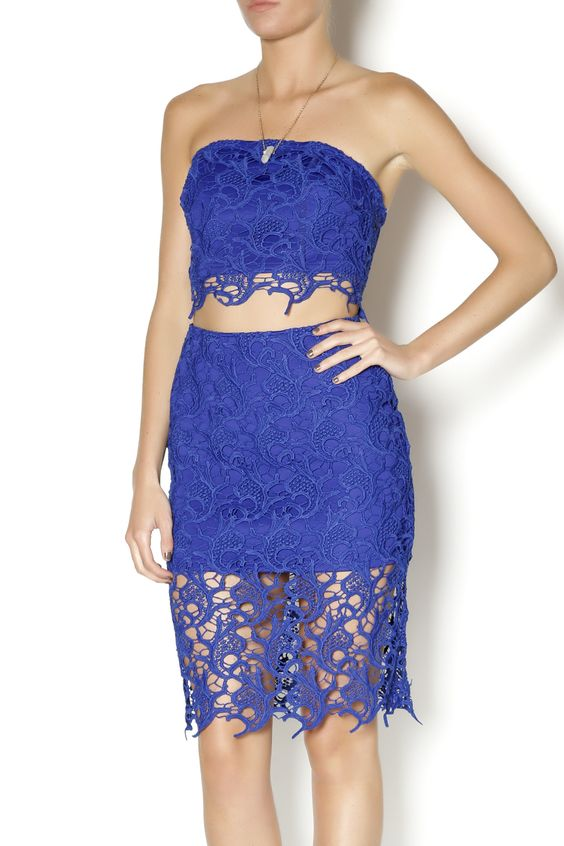 Two piece blue crochet top and skirt. The top is strapless with a hook and eye back closure. Wear this two piece set together or separately.  Blue Crochet Two Piece by gold label. Clothing - Matching Sets Miami, Florida