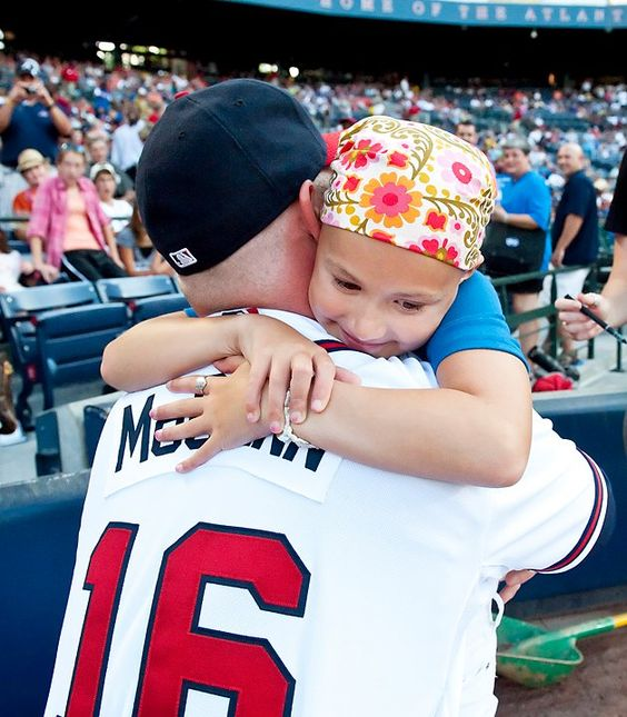 BMAC huges this little girl with cancer.
