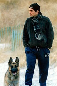 JFK, Jr.....This post is much, much after the fact. But I would take that dog (let's say un-housebroken) everyday of my life to wake up to that face every morning (and I don't mean the dog's).