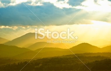 golden sun rays over land Royalty Free Stock Photo