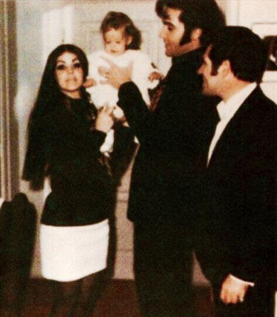 Priscilla, Lisa Marie and Elvis with Charlie Hodge celebrating Christmas at Graceland, December, 1969.