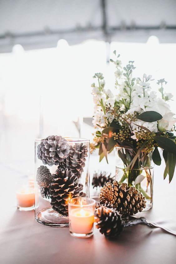 Pinecone Centerpiece - pile crisp clean pinecones into clear glass vessels to introduce a rustic touch tailor made for minimalists ELLEDecor.com