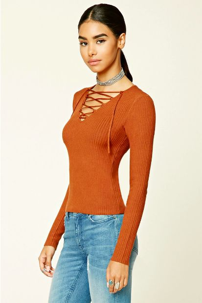 This cinnamon lace-up sweater that'll keep your top half toasty. | 19 Going-Out Looks For When It's Cold As Balls