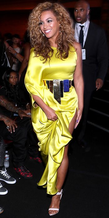 Beyonce hit the BET Awards in a belted chartreuse satin Stephane Rolland gown and Lorraine Schwartz diamond-and-titanium earrings.