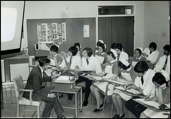 Nursing students learning from a projector in 1972. This photo is from the Middlewood Hospital in Sheffield, UK