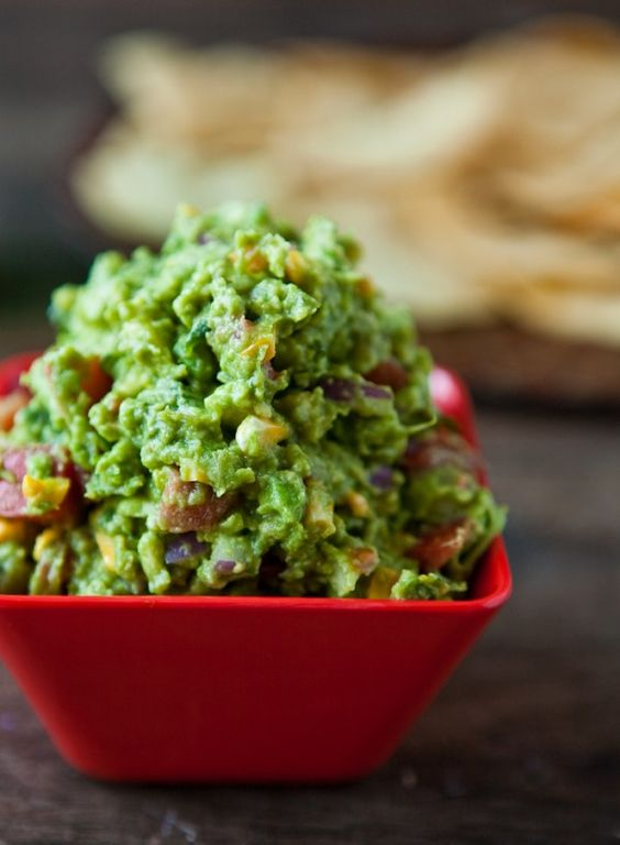 Roasted Corn Guacamole from Eclectic Recipes. http://punchfork.com/recipe/Roasted-Corn-Guacamole-Eclectic-Recipes